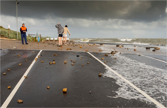 Debris litters the car park as more storm clouds gather