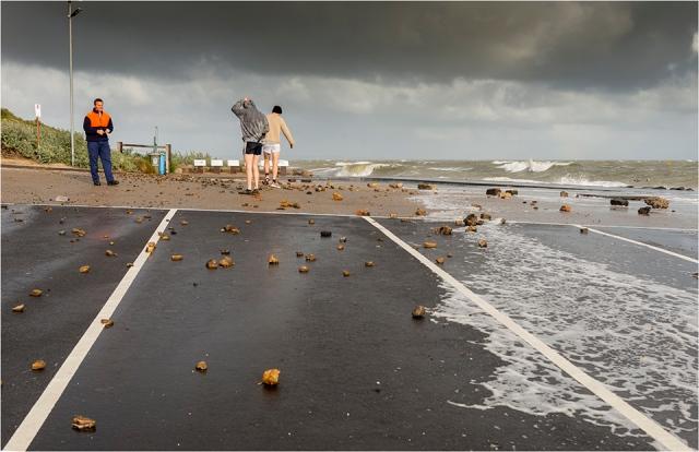 Debris litters the car park as more storm clouds gather
