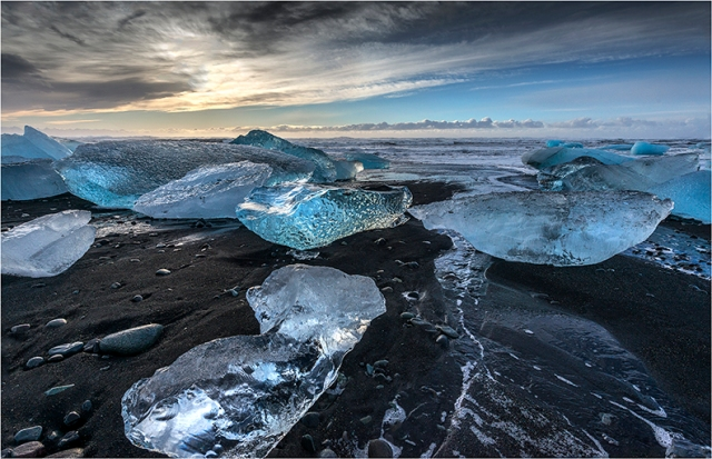 Jokulsarlon Beach Littered With Icebergs - Greg Earl